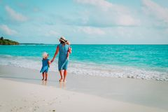 Mother with kids walk on beach, family vacation royalty free stock photography