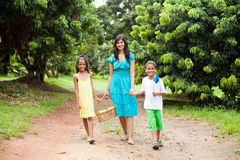 Mother and kids walking Royalty Free Stock Photos