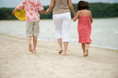 Mother and kids walking Stock Photo
