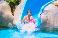 Mother and kids at water slide Stock Photo