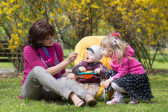 Mother with kids Stock Images