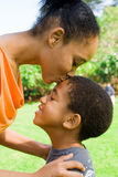 Mother kiss. Young african american mother kiss her boy Royalty Free Stock Photo