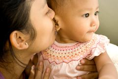 Mother kiss baby stock photo