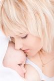 Mother kiss and breast feeding her baby Royalty Free Stock Photography