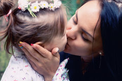 Mother kiss her daughter Royalty Free Stock Photo