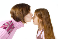 Mother kiss her little daughter Royalty Free Stock Image