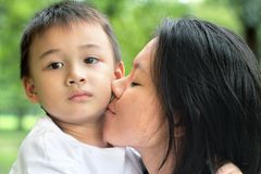Mother kiss her son Stock Image