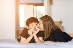 Mother kiss her son in bedroom Royalty Free Stock Photography