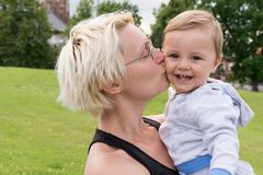 Mother kiss her son Royalty Free Stock Images