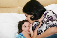 Mother kissed her little baby Stock Images