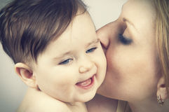 Mother Kissed Her Little Baby, Close-up Stock Photo