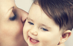 Mother Kissed Her Little Baby, Close-up Stock Images