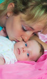 Mother kisses the child Stock Photography