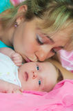 Mother kisses the child Royalty Free Stock Photos