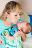 Mother kisses the child Royalty Free Stock Image