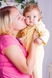 Mother kisses child Stock Photo