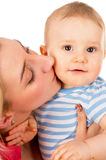 Mother kisses her baby Stock Photography