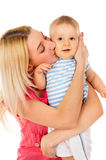 Mother kisses her baby Royalty Free Stock Photo