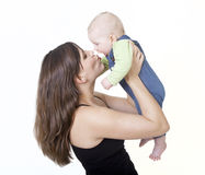 Mother kisses her baby Stock Image