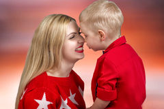 A mother kisses her child.Little boy a tender embrace. Royalty Free Stock Images