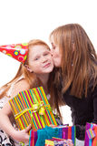 Mother kisses her daughter in her birthday Stock Photo