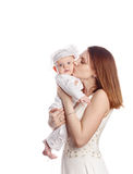 A mother kisses her daughter. Isolated. Royalty Free Stock Images