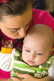 Mother kisses her son. 's head tenderly with love Stock Images