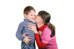 Mother kisses the small son Royalty Free Stock Image
