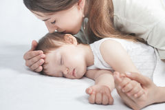 Free Mother Kissing A Baby. Care Concept Stock Photo - 71163310