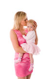 Mother kissing baby Royalty Free Stock Photo