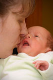 Mother kissing baby Royalty Free Stock Photography