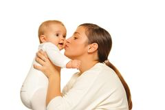 Mother kissing  baby Stock Image
