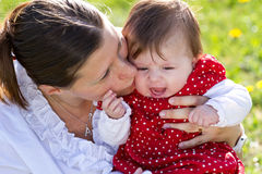 Mother kissing baby Royalty Free Stock Images