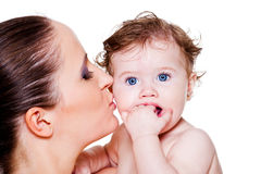 Mother kissing baby Stock Photo