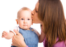 Mother kissing baby boy Stock Photo