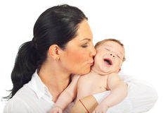 Mother kissing baby boy Royalty Free Stock Photography