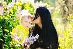 Mother kissing baby daughter Royalty Free Stock Photos
