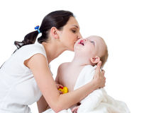 Mother kissing baby girl after bathing Royalty Free Stock Photography