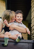 Mother kissing baby outdoors Stock Photography