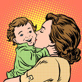 Mother kissing baby. Pop art retro style. Childhood and motherhood. Love women and son Stock Photos