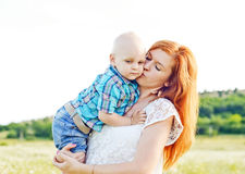 Mother kissing baby son Stock Photo