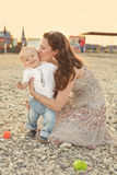 Mother kissing baby son Royalty Free Stock Images