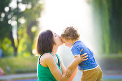 Mother kissing baby. Stock Photos