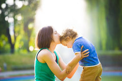 Mother kissing baby. Royalty Free Stock Image