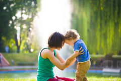 Mother kissing baby. Stock Image
