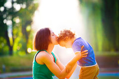 Mother kissing baby. Royalty Free Stock Photos