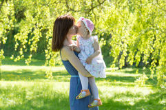 Mother kissing child girl Royalty Free Stock Photography