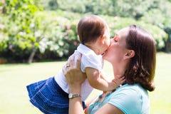 Mother kissing daughter Stock Photos