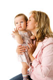 Mother kissing daughter Royalty Free Stock Photos