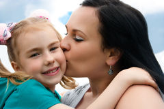 Mother kissing daughter Royalty Free Stock Photography